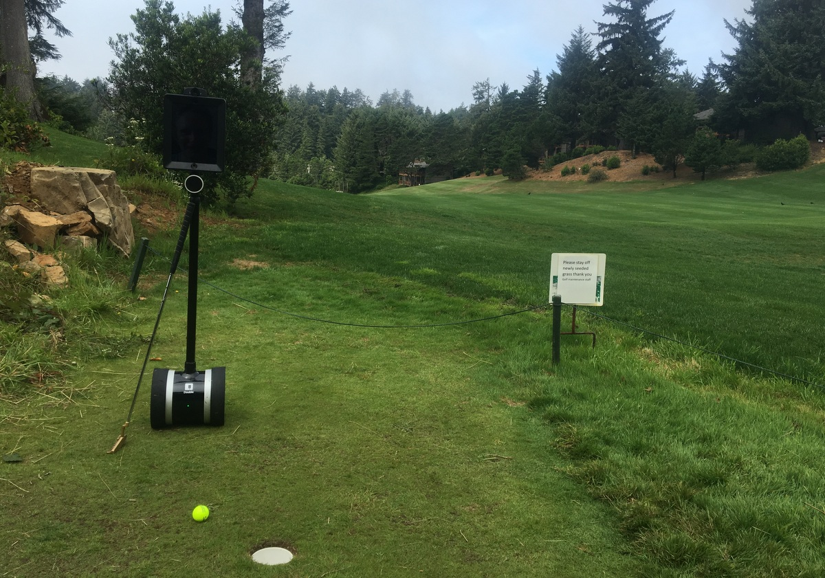 Double 2 telepresence robot playing golf