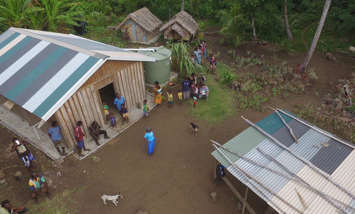 Drone aerial view of inhabitants of the South Pacific island nation of Vanuatu.