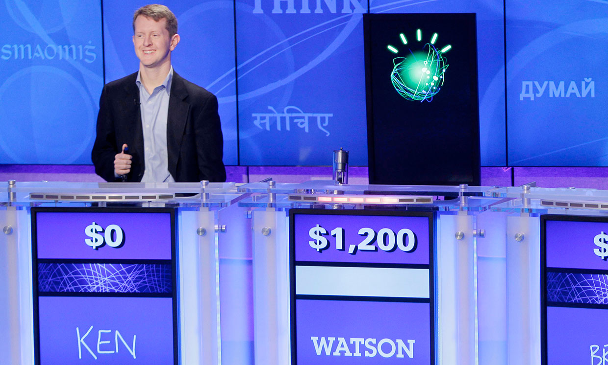"""Jeopardy!"" champions Ken Jennings, left, looks on as ""Watson"" beats him to the buzzer."